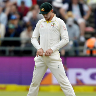 Bancroft attempting to hide the sandpaper he was using.