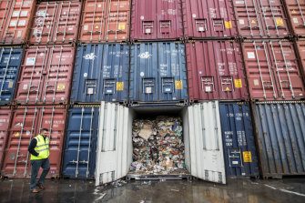 Going nowhere: Containers filled with waste from recycling business SKM in Brooklyn last month.