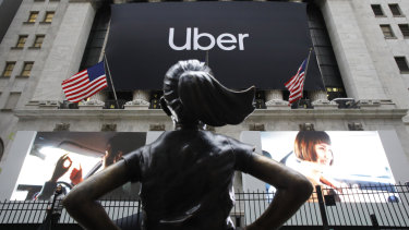 The statue of Defiant Girl stands in front of the New York Stock Exchange where Uber, the world's largest ride-sharing service, held its initial public offering.