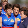Dogs have their day: Luke Beveridge with his players during quarter time break in the round 23 win over Adelaide that sealed their spot in finals.