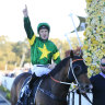 Tommy Berry  celebrates as Ole Kirk returns to scale after the Golden Rose.