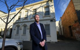 Unison CEO James King outside the rooming house in Collingwood.