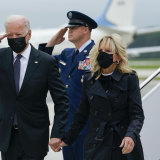 President Joe Biden returns a salute as he and first lady Jill Biden arrive at Dover Air Force Base on Sunday.