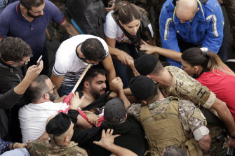 Scuffles break out between protesters and Lebanese army soldiers in Jal al-Dib, north of Beirut, on Wednesday.