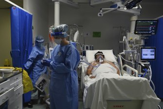 Intensive care staff at St Vincent's Hospital looking after a patient with COVID-19 on Tuesday.