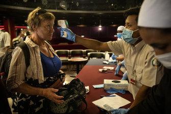Passengers preparing to disembark the Westerdam gather for a final health screening last week.