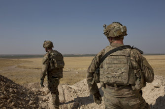 US soldiers pictured last month surveying the safe zone between Syria and the Turkish border near Tal Abyad, Syria.