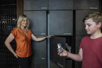 Lisa McLean, CEO of NSW Circular, and her son at the interactive waste wall at The Yarn in Hunters Hill.