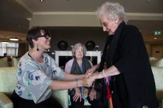 Kiama's council-run nursing home, Blue Haven, has fewer residents than most, with residents clustered around a central hub.  Photo shows Dr Louisa Smith from the University of Wollongong who has been leading a project to help aged care workers connect with residents at Blue Haven Care including (L-R) Mavis Cummins  and Margaret Murphy.