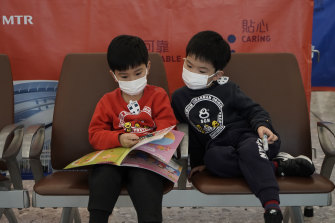 Passengers wear masks in the high speed train station in Hong Kong.
