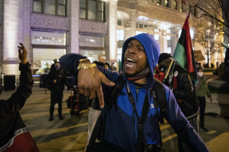 Dozens of protesters march down the Magnificent Mile on Thursday evening after Chicago released videos of 13-year-old Adam Toledo being fatally shot by a Chicago police officer.