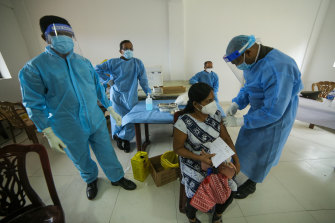 Sri Lankan health workers administer second doses of Sinopharm in Colombo, Sri Lanka in mid June.