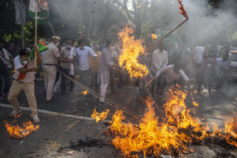 An effigy of Uttar Pradesh chief minister Yogi Adityanath is burned during a protest.