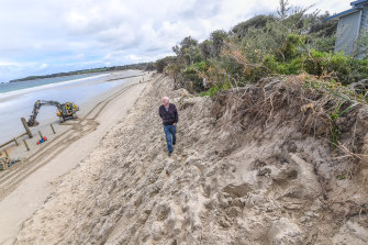 Dave Sutton inspects the foreshore at Inverloch, where remediation attempts have failed to prevent accelerating erosion.