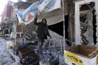 A man sorts through the damage to a shop in the city of Saraqeb in the Idlib countryside after an air strike by Syrian aircraft last week.