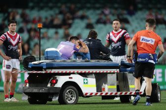 Shaun Johnson leaves the field on a medicab.