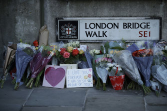 Tributes are placed by the southern end of London Bridge, three days after a man stabbed two people to death and injured three others before being shot dead by police in London..