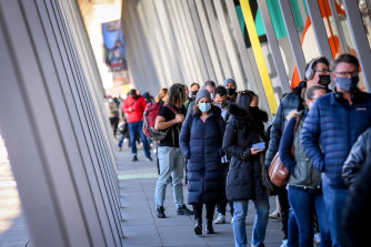 People queue up for COVID-19 vaccination at the Melbourne Convention and Exhibition Centre this week.
