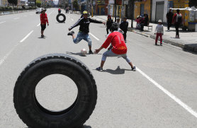 Children play soccer in El Alto, on the outskirts of La Paz, on Sunday. Cars are banned and shops are closed during national elections.