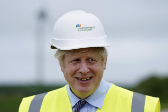British Prime Minister Boris Johnson, seen here at a wind farm in Cornwall on Wednesday, will push Australia on climate change action.