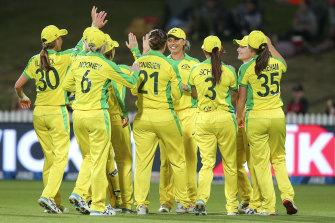 The Australians celebrate after the dismissal of New Zealand captain Sophie Devine.