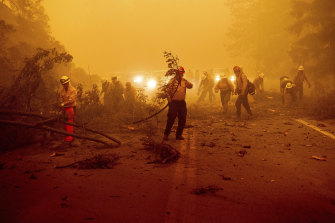 Firefighters battling the Dixie Fire in Plumas County, California.