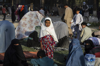 Displaced families wait in a makeshift camp in Share-e-Naw park in Kabul.