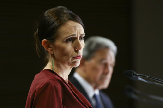 Prime Minister Jacinda Ardern and Deputy Prime Minister Winston Peters speak to media at a press conference following a COVID-19 financial response package announcement at Parliament on Tuesday.