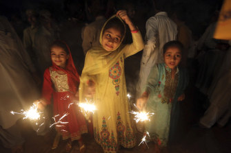 Children from the Pakistani Hindu community hold fireworks during a special ceremony to celebrate Diwali festival.