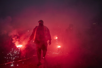 Railway workers in Paris walk towards French riot police during the protests earlier this week.
