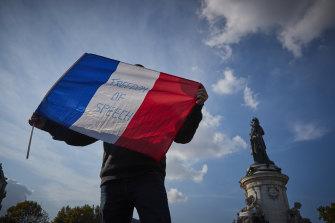 Parisians have been holding vigils for beheaded teacher Samuel Paty.