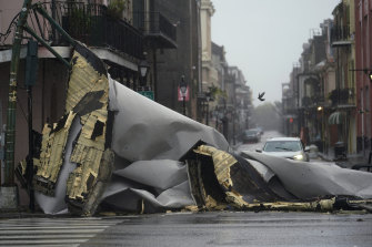 A section of roof that was blown off a building by hurricane Ida blocks an intersection in New Orleans' French Quarter on Sunday.