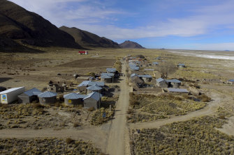 Residents walk along a dirt road in the Urus del Lago Poopo indigenous community, which sits along the salt-crusted former shoreline of Lake Poopo, in Punaca, Bolivia.