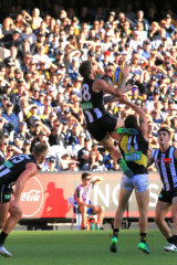 Spectacular: Jeremy Howe flies high for Collingwood.