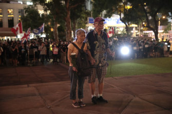 An elderly couple in front of the Cenotaph to mark the 74th Anniversary of the Liberation of Hong Kong.