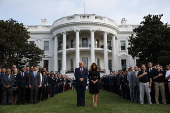President Donald Trump and Melania Trump participate in a moment of silence honouring the victims of the September 11 terrorist attacks.