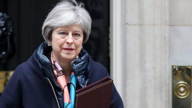 Theresa May leaves number 10 Downing Street before the deadline on Tuesday.