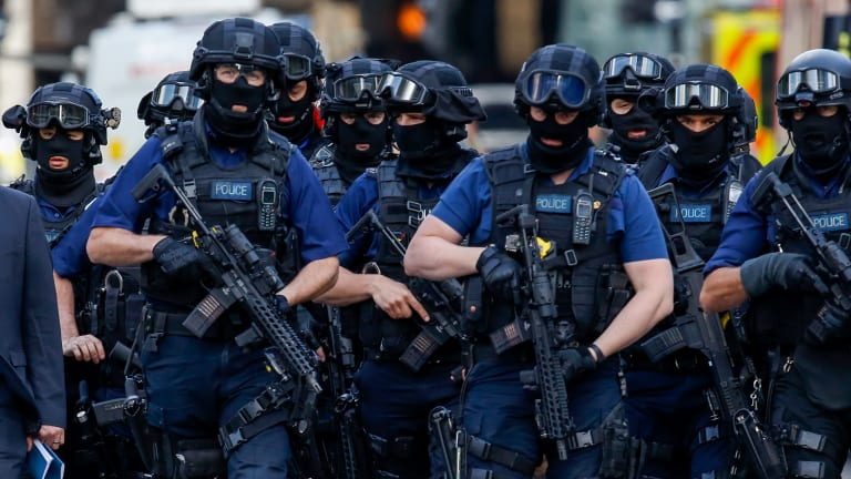 Armed police officers patrol streets near the scene of a terror attack in London in June last year.