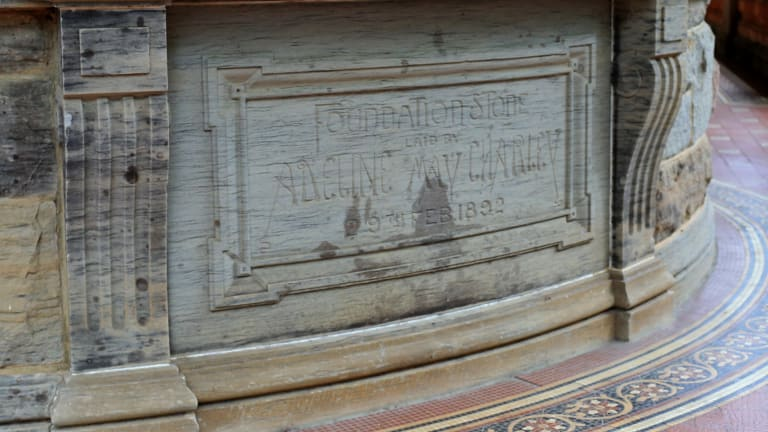 The foundation stone says it was laid by Adeline May Charley in 1892.