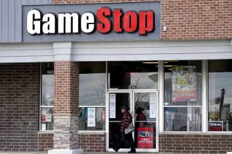 GameStop shares have tumbled after new restrictions were placed by online brokerages.