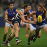 Geelong kick away from brave Bulldogs to keep top spot