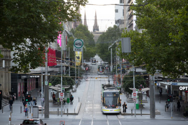 Popular Melbourne shopping strip Bourke St Mall has remained empty throughout the virus, though retailers have been encouraged to re-open stores.