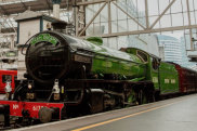 Steam Dreams is running steam train services from London Waterloo to Windsor. The bright green train is the Mayflower, a B1 Class Locomotive built in 1948 and sporting its original British Rail apple green livery.