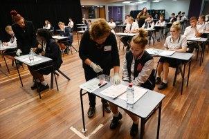 Year 12 students at Penola Catholic College in Emu Plains finish their English HSC exam.