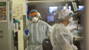 Healthcare workers inside one of the coronavirus wards at the Austin Hospital this week.