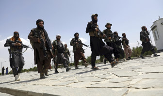 Taliban fighters on patrol in Kabul. Afghanistan is sitting on what may be the world's largest lithium reserves.