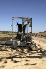 A 49-year-old truck driver escaped uninjured from a fire that engulfed a semi-trailer.