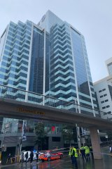 Part of Market Street and the overhead walkway to Pyrmont Bridge have been closed following concerns a glass panel might fall from an office building.