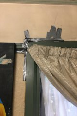 Cracks appear: like many other carers Christina Johns can't afford basic repairs to her home.