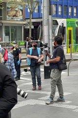 Videographer Real Rukshan, aka Rukshan Fernando,filming in Melbourne's CBD this week.